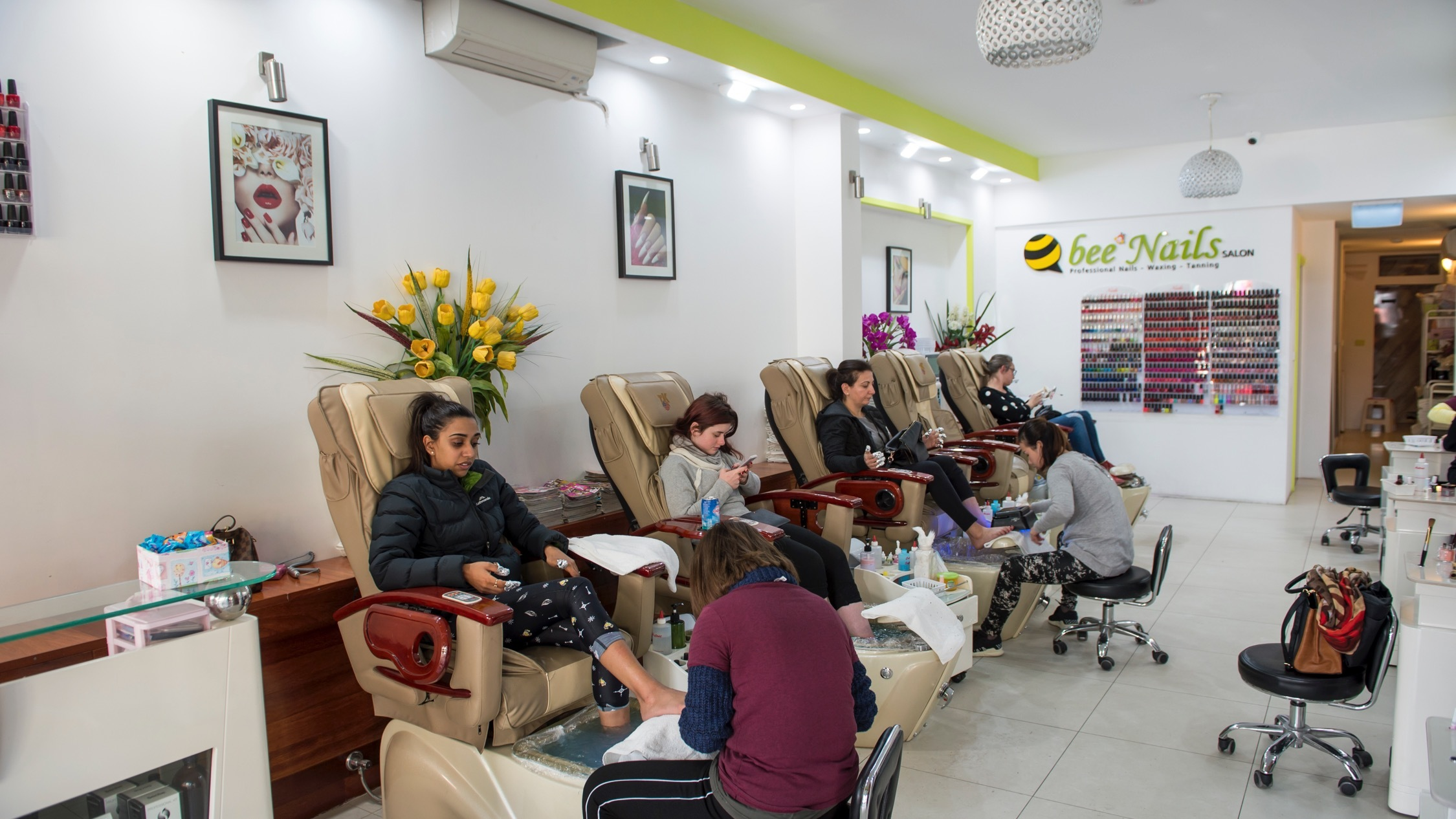 People getting their nails done at Q bee Nails