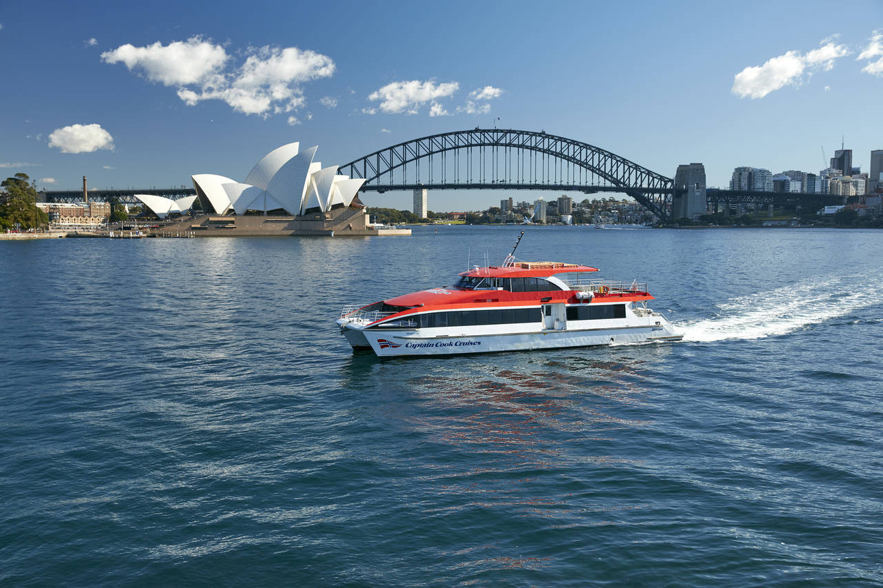 Ferry in Sydney Harbour with Opera House and Bridge in the background