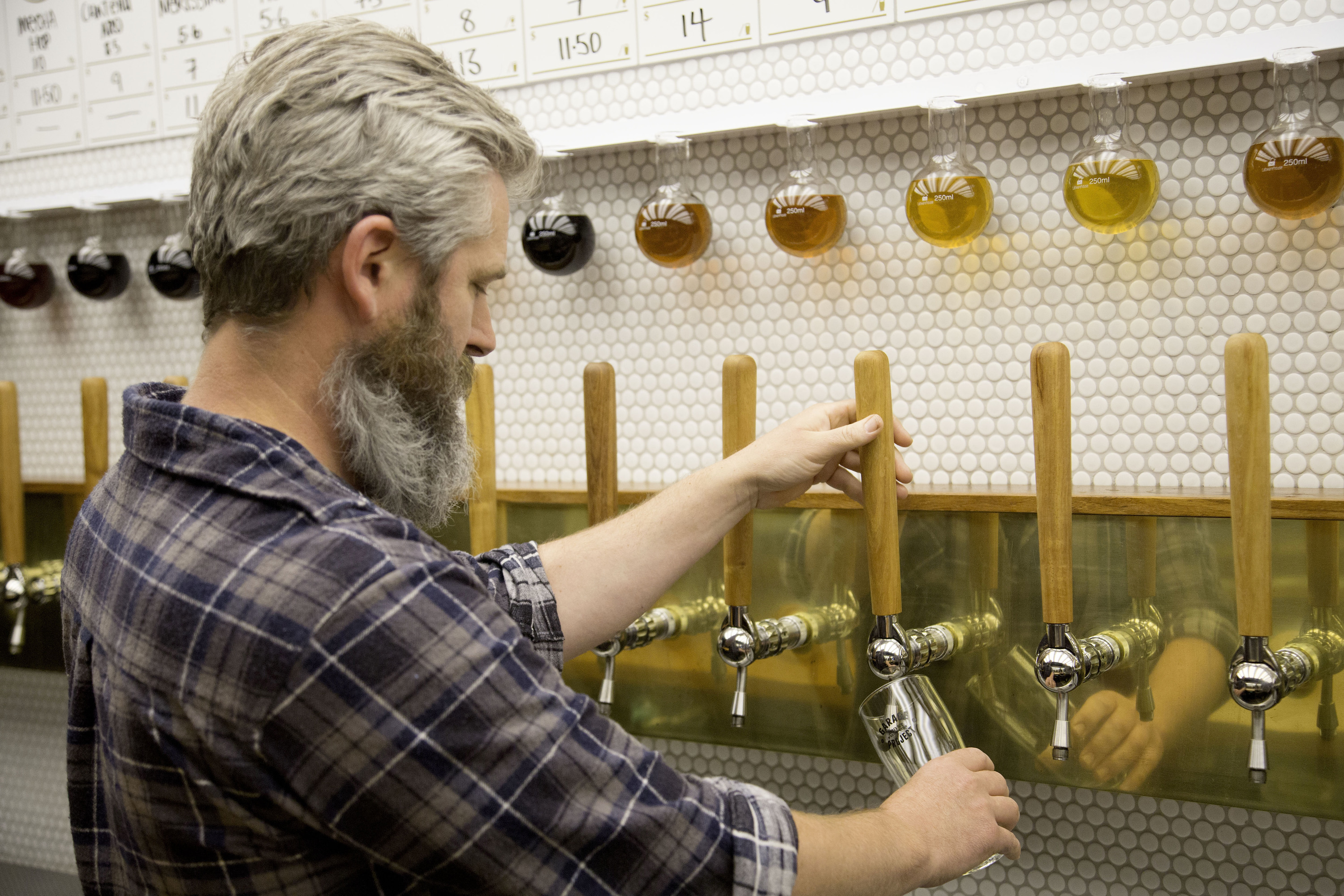 Pete pouring a beer at Taproom