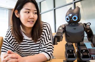 Portrait of Hae Won Park with a robot