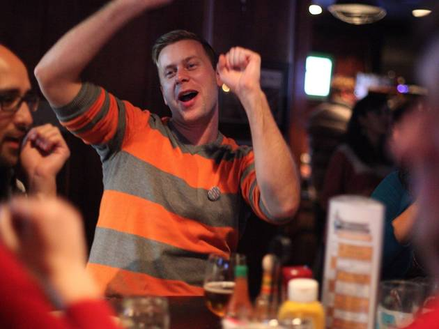 Man cheering at Pub trivia