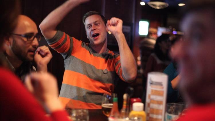 Man cheering at Pub trivia