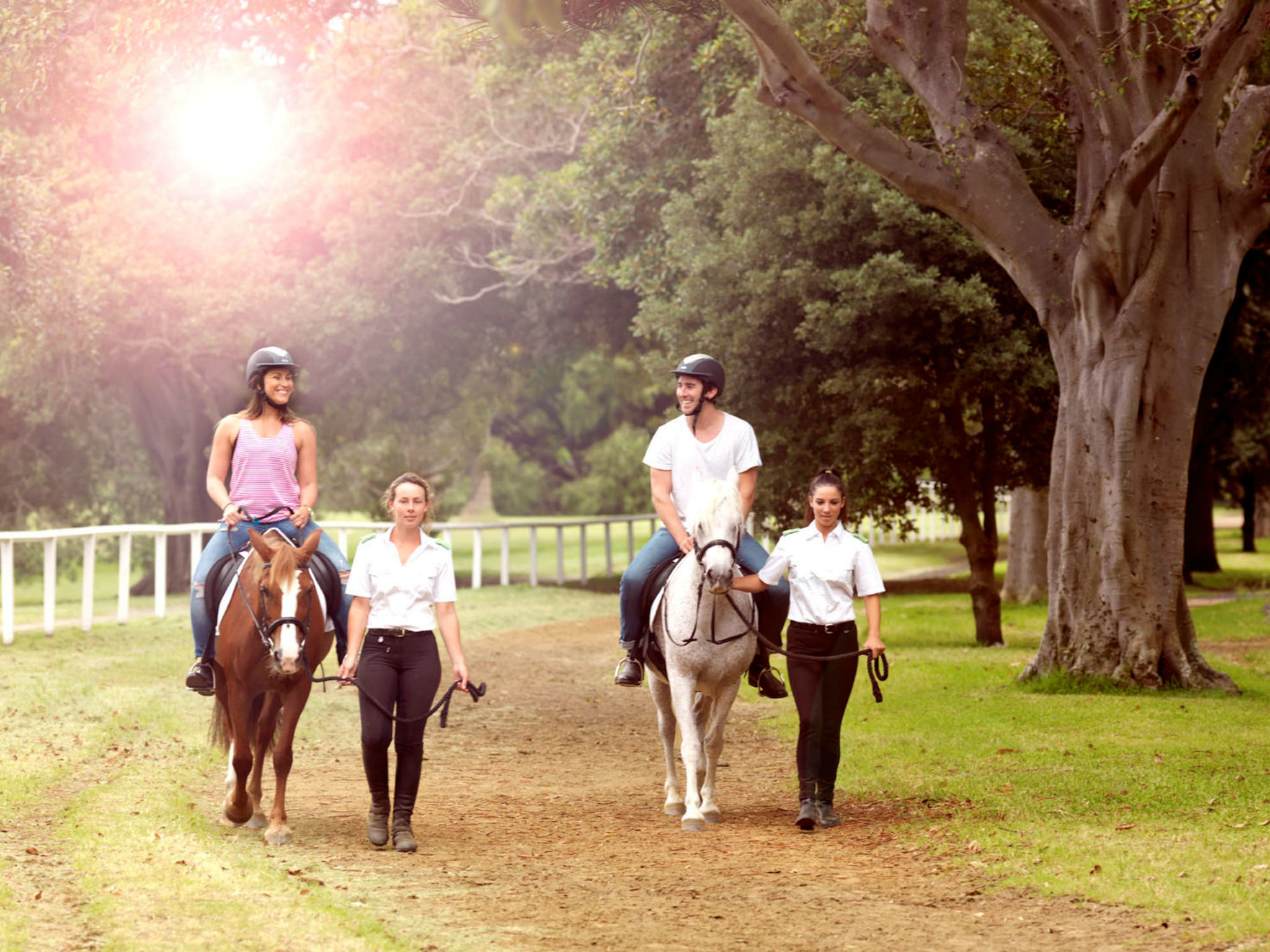 Couple horse riding in Centennial Parklands
