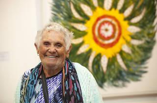 Euphemia Bostock standing in front of her art