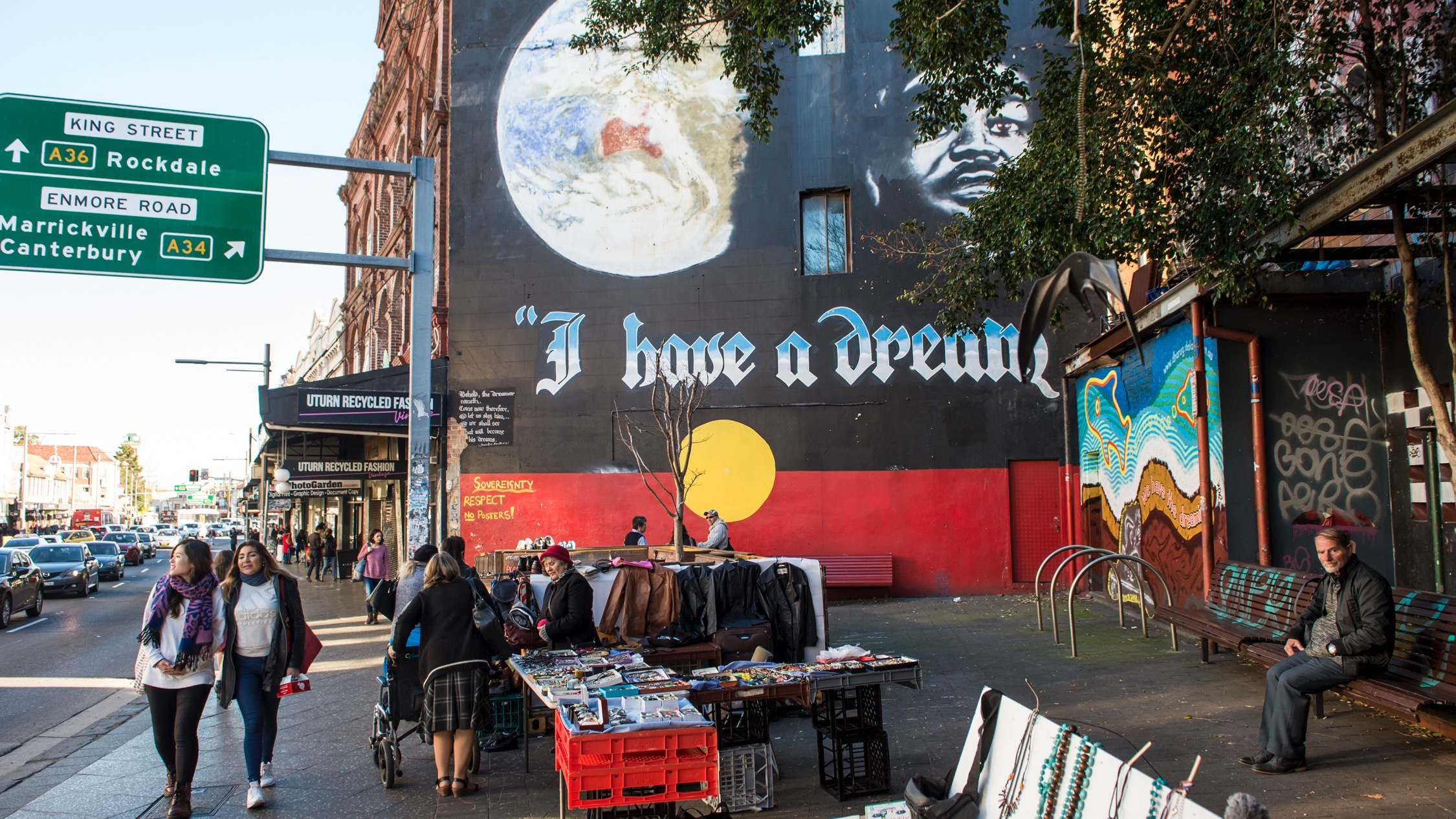 I have a dream mural, market stall on street at Newtown