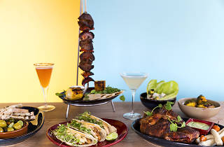 A spread of meat dishes and cocktails from Pablo's Cantina