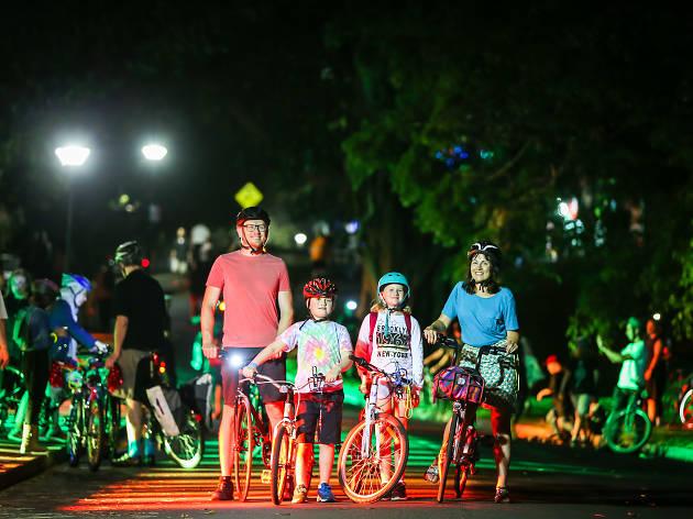 Family rides at night.
