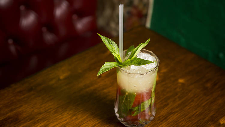 Plastic straw in cocktail