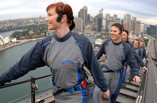 People climbing the Sydney Harbour Bridge.