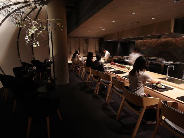 People sitting eating inside at Ishizuka