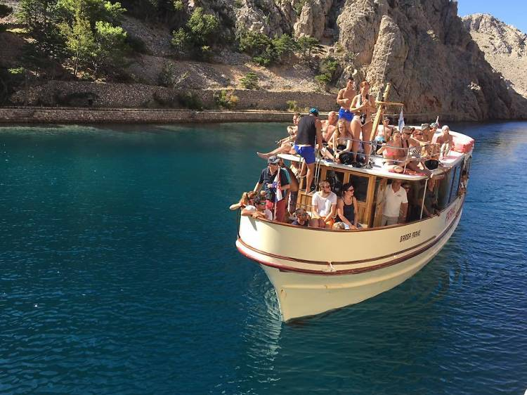 Discover Rab island in a glass-bottom boat