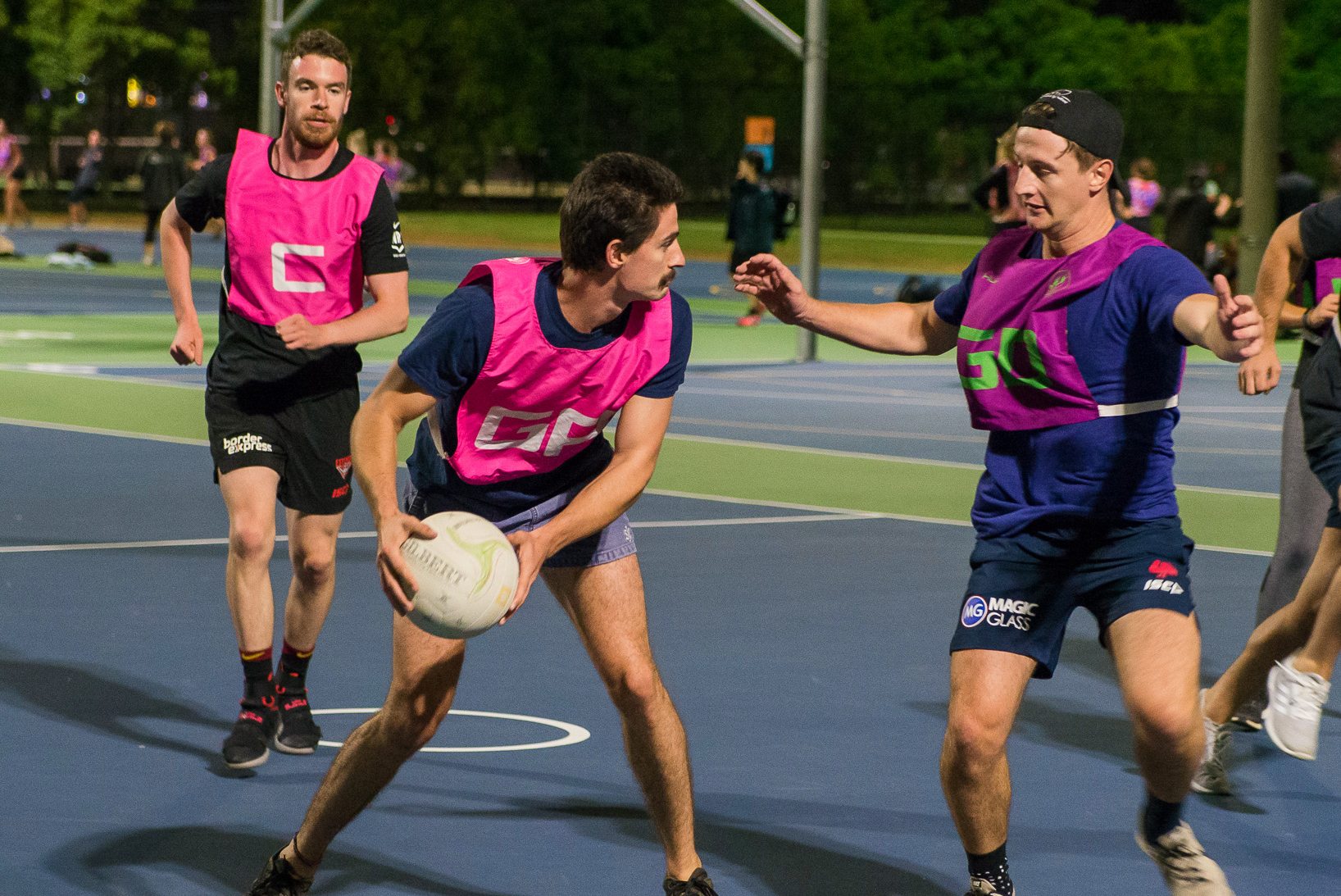 Men play a game of netball.