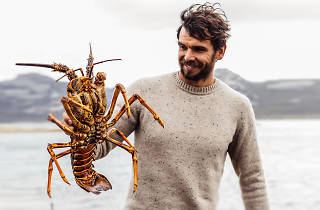 Mark LaBrooy holding a crayfish