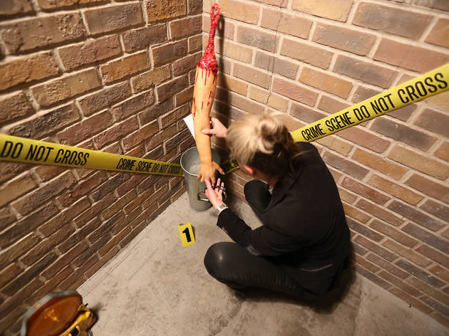 Woman in the corner of an escape room with a clue