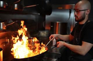 Person cooking at Sunda