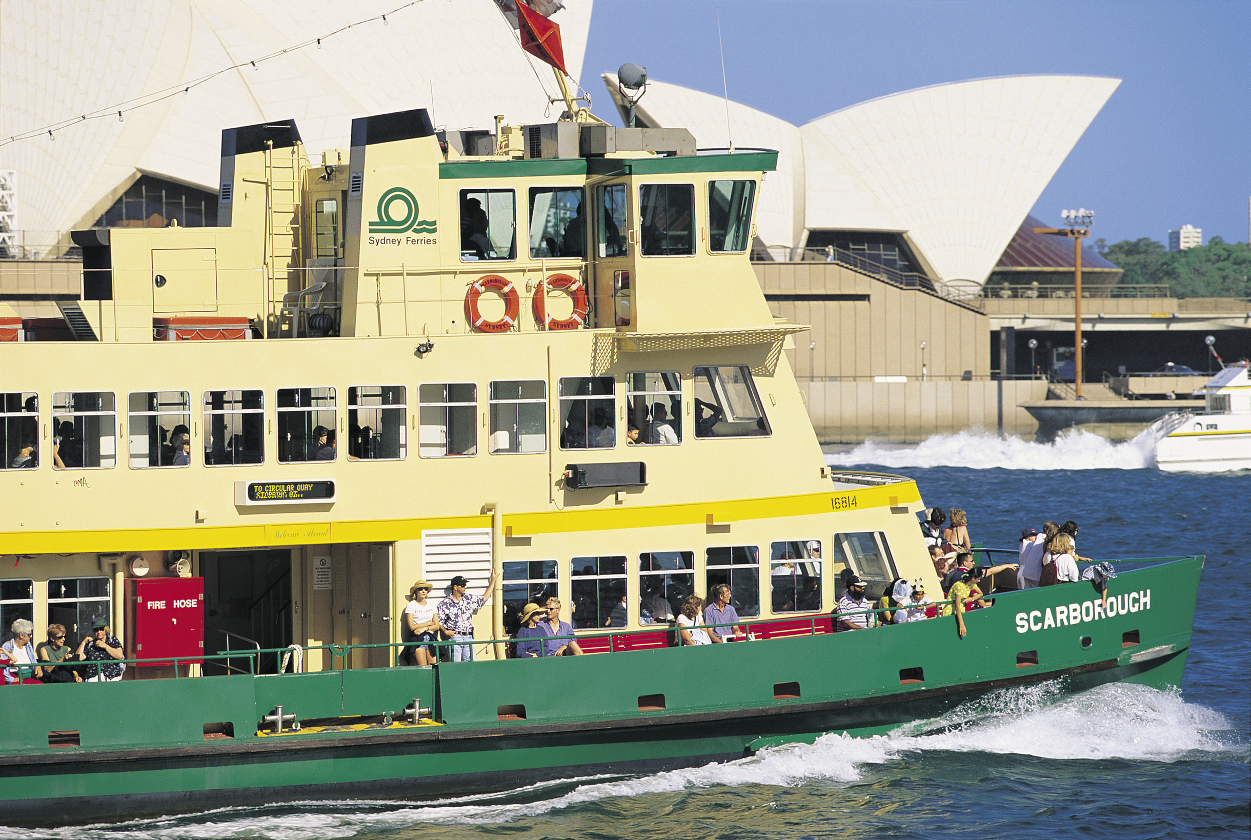 Ferry glides past the Sydney Opera House.