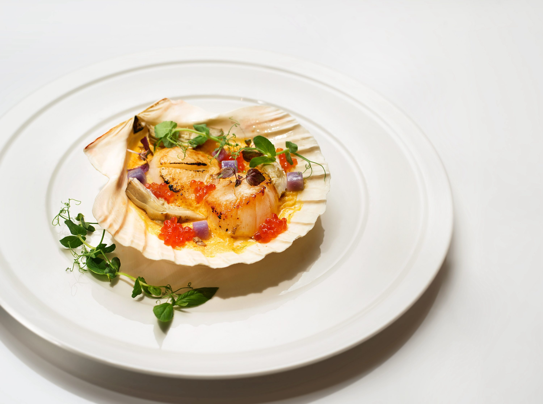 Pan fried scallops with artichokes, purple potatoes, salmon egg roe and sea urchin sabayon
