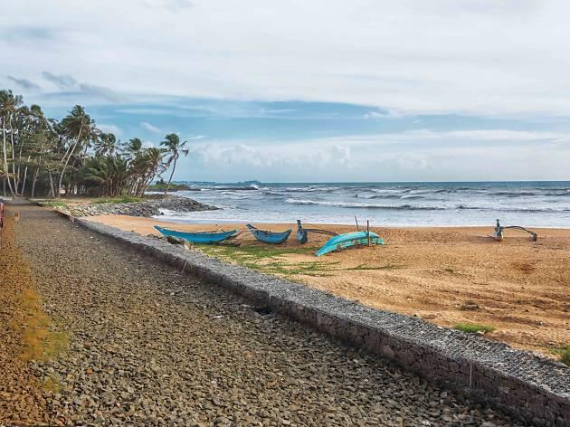 Fishing boats lying on the beach at Kudapayagala