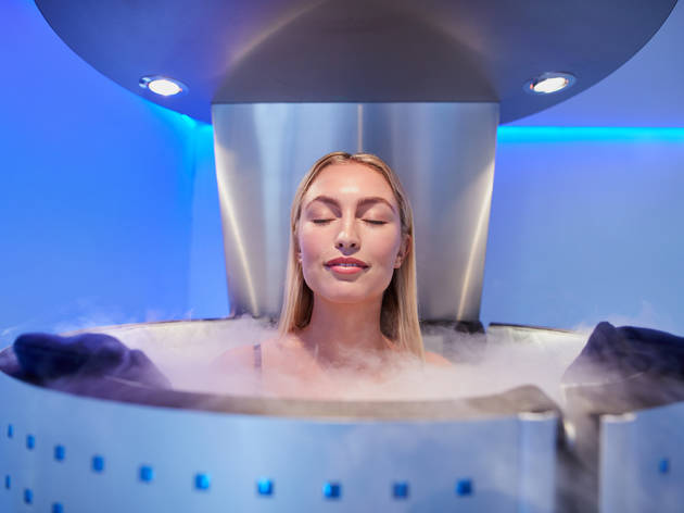 Woman in cryotherapy bath