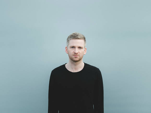 Olafur Arnalds press image in front of blue background