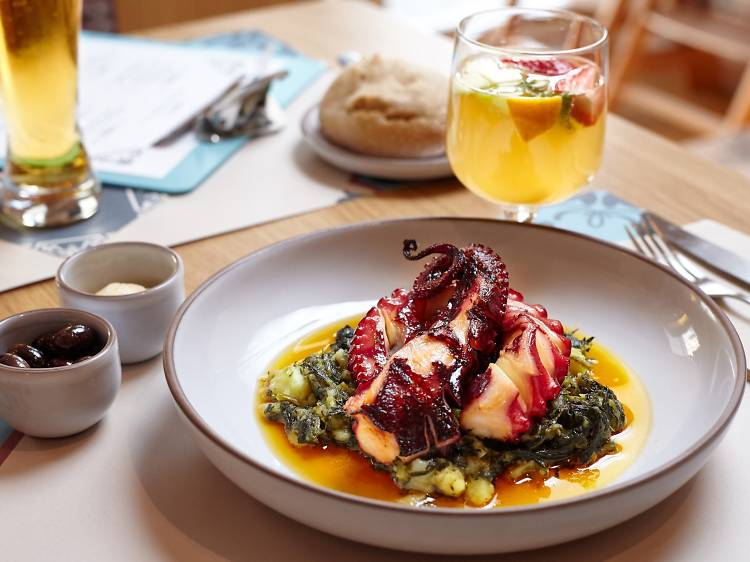 Go to a Portuguese food restaurant with two Michelin stars