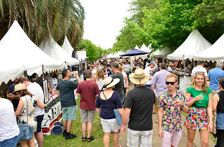 People walk through the stalls at the festival.