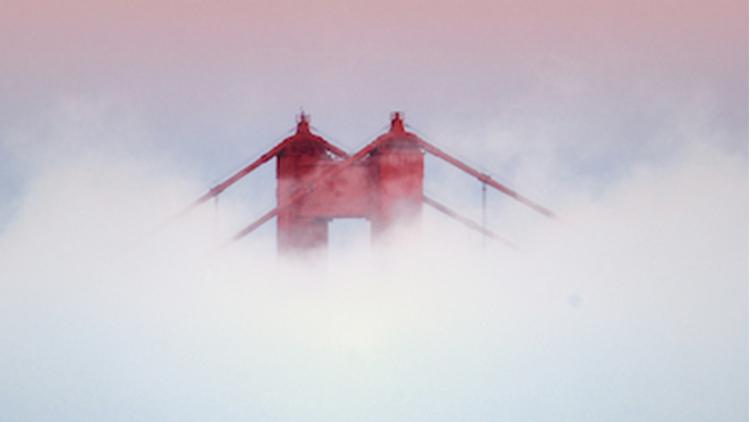Golden Gate Bridge Tower covered in fog