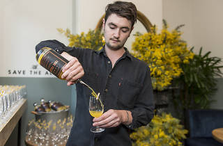 Man pouring cocktail in wattle room