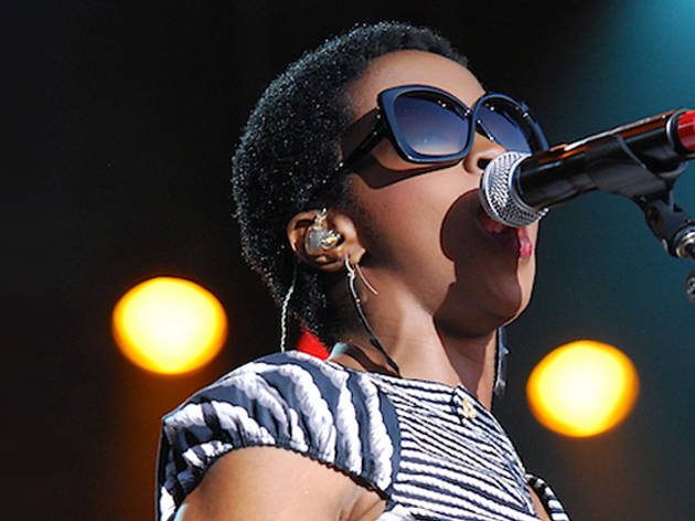 Lauryn Hill singing into microphone
