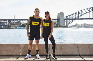 Sexy people stand in front of the Harbour Bridge.