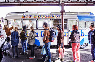 People in a queue at American Doughnut Van