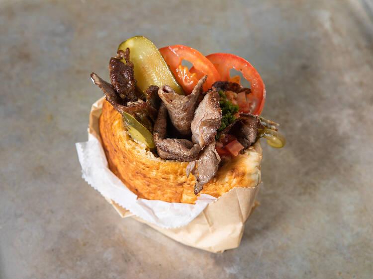 Folded cheeseburger in a pita at Miznon