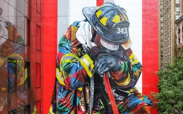 A giant mural of a firefighter was unveiled in midtown on 9/11