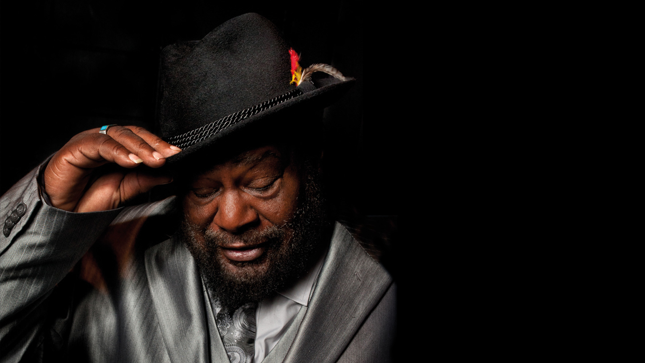 George Clinton wears a hat.