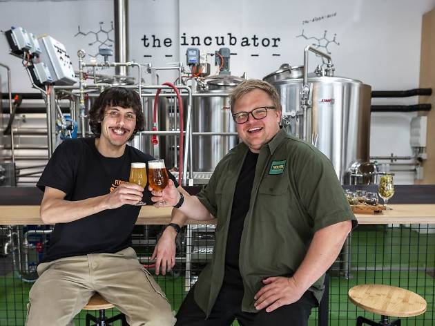 Two men enjoying beer at Fixation Brewing Company
