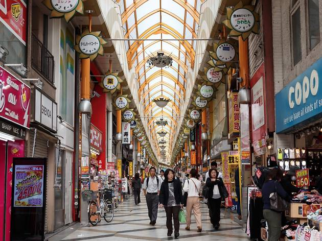 People walking inside Nakano Sun Mall Shotengai
