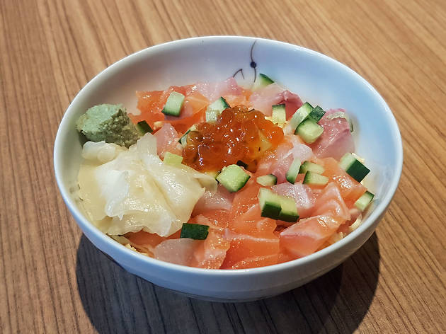 A bowl of raw fish and rice