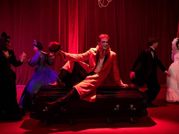Full cast in red ballroom at A Midnight Visit