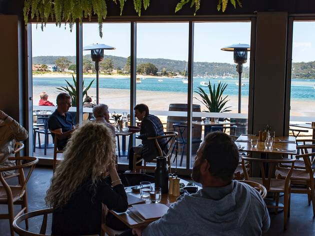 People eating outside Of box on the water central coast