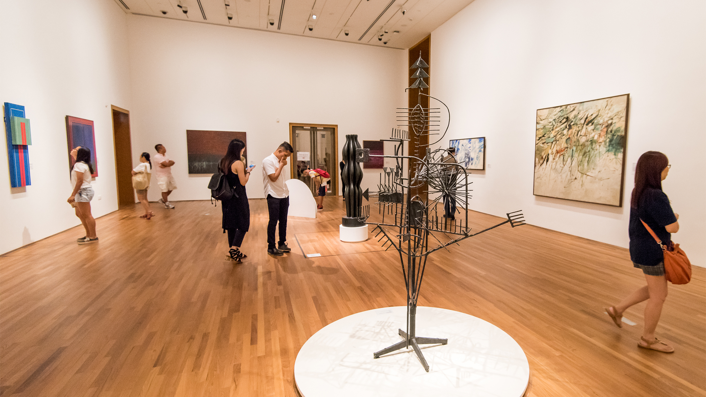 People viewing artwork at National Gallery Singapore