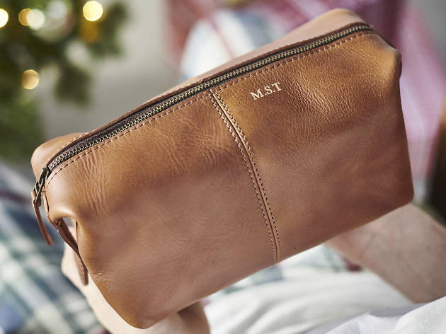 Xmas gift guide men: Personalised leather wash bag from Not On The High Street, 2018