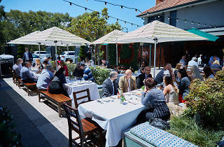 People dining in a beer garden