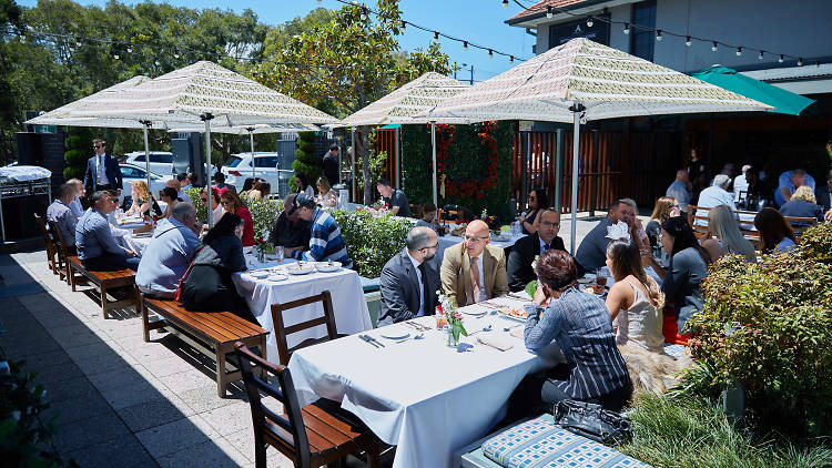 People dining in a beer garden