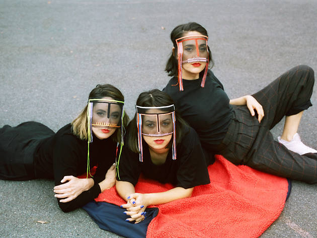 Press shot for 2019 tour, band laying on the ground, masks on looking at the camera
