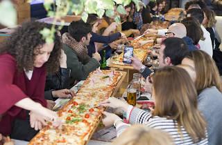 Kilómetros de Pizza