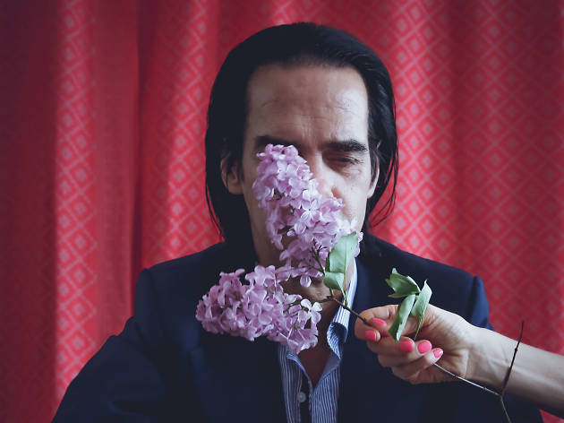 Press photo of Nick Cave with flowers