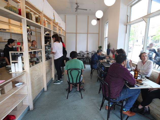People sitting inside eating at Ima Project Cafe