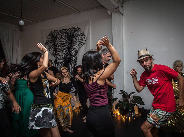 People dancing at Conscious Warehouse party