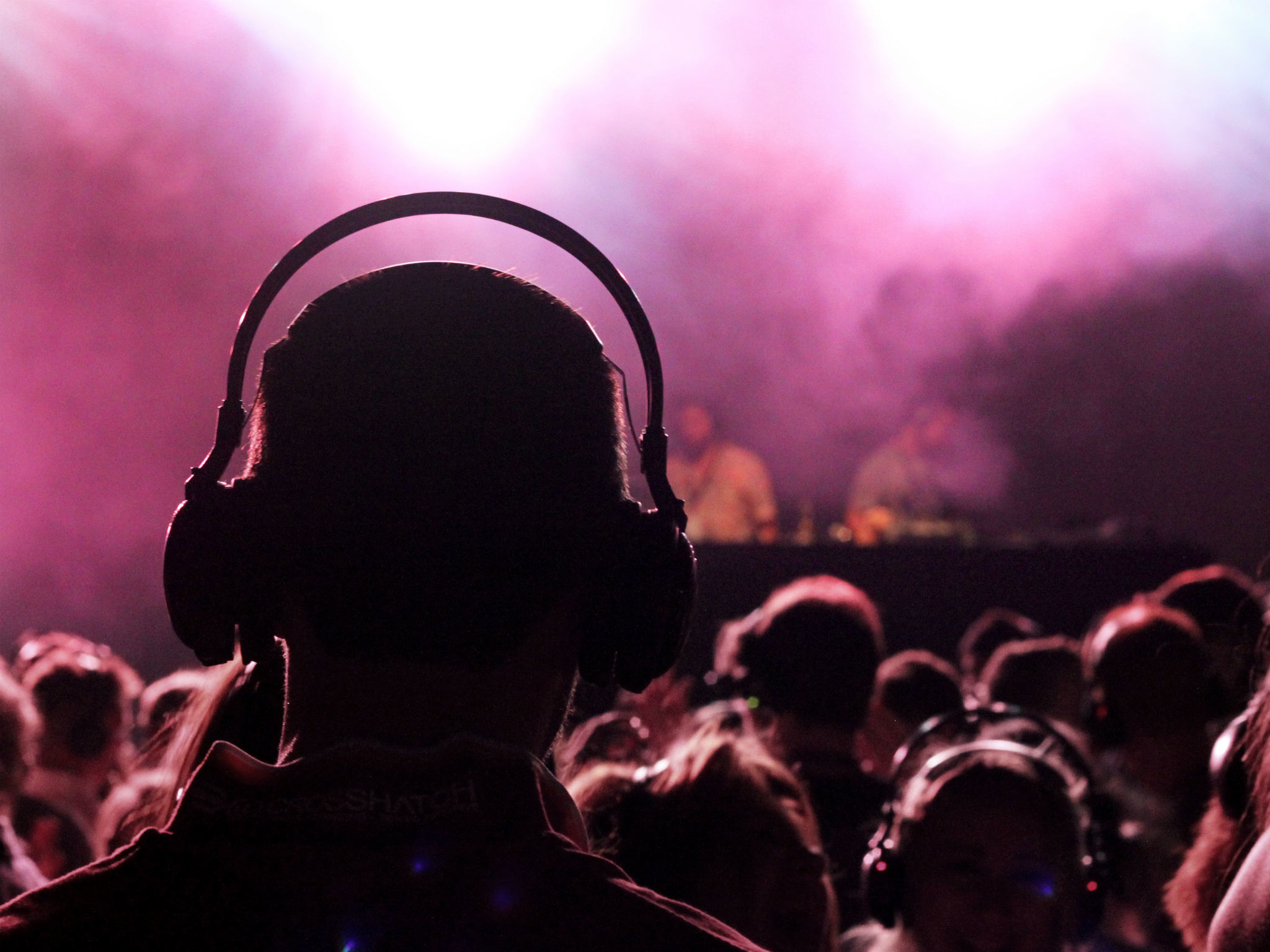 Person with headphones at a nightclub