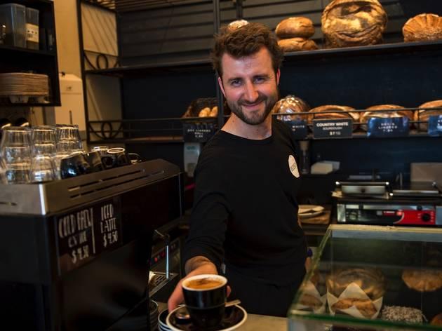 Person holding coffee at Sonoma Glebe